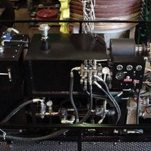Diesel hydraulic power pack complete with fuel tank and hydraulic controls installed.