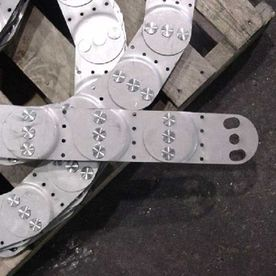 Stainless steel side plate sub assemblies.